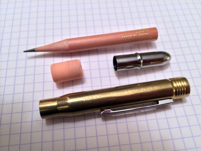 The four components that make up the Midori brass bullet pencil. Simple and high-quality.